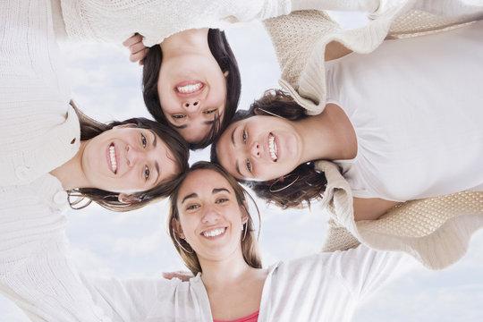 Hispanic women hugging in circle