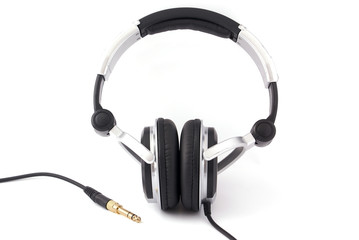 Headphones with gold plug on white background