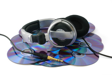 Headphones on CD disks on white background
