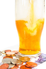 Pint of lager and money