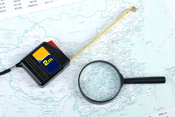 magnifier,steel tape with map