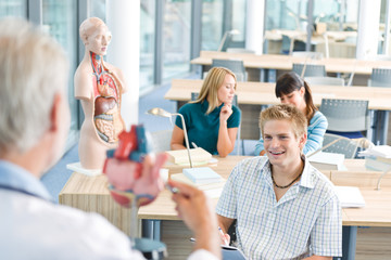 University - medical students with anatomical model