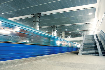 blue moving train with staircase