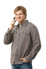 Casual young man talking on mobile