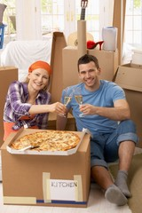 Couple celebrating new house with champagne