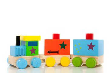 A colorfol wooden toytrain isolated over white