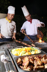 chef cooking at barbecue dinner