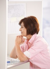 Senior woman sitting in office
