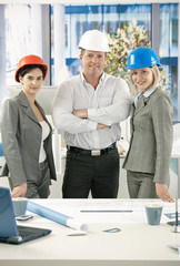 Architects in office wearing hardhat