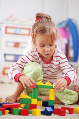 Child playing with bricks