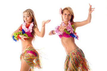 two pretty dancers in hawaiian costumes isolated