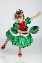 Beautiful little girl playing with hat on Saint Patrick's Day