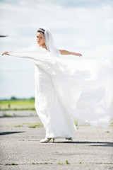 bride dance on  airfield