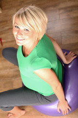 Pregnant Woman exercising on ball