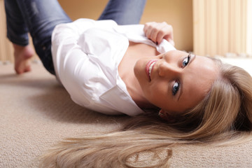 Young sexy beautiful woman lying on the floor