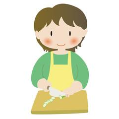 料理をする女性──切る