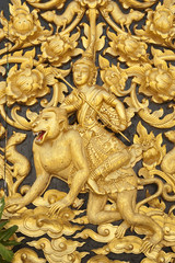 Traditional Thai style wood carving on door