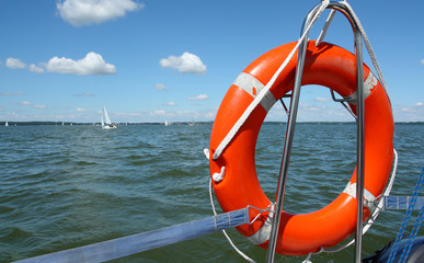 red lifebuoy on yacht , background made from lake