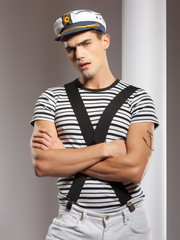 portraitof a young man dressed like a sailor