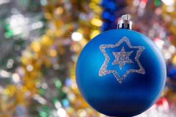 Blue sphere with brightly snowflake on the colored background