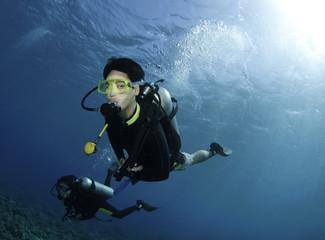 Asian scuba divers