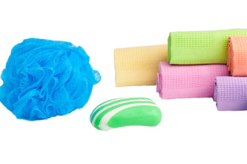 Sponge, soap and towels on a white background..