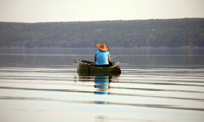 Woman on a boat in the fishing lake