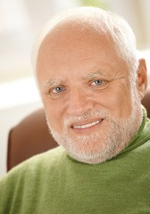 Closeup portrait of cheerful old man