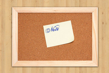 Corkboard with empty yellow notes on maple wood