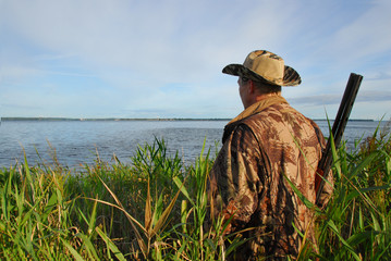 hunter waiting in the reeds