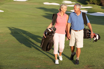 Poster Golf Senior Couple Walking Along Golf Course Carrying Bags