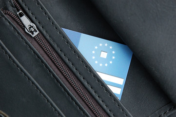 Black wallet with health insurance card