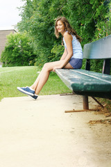 Teen siting on a bench