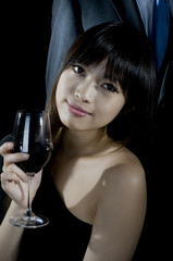 Chinese woman drinking wine