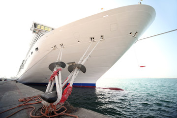cruise ship standing in dock, mooring with ropes