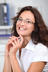 Closeup of smiling businesswoman wearing eyeglasses