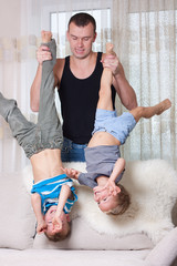 Father playing with his two sons.
