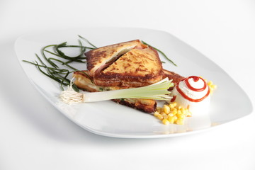 Tasty looking sandwich served with various vegetables