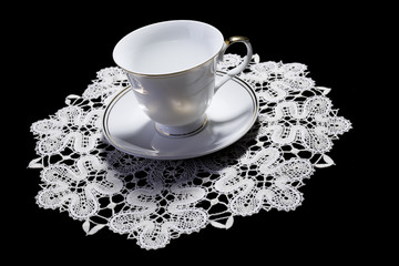 White cup on small doily
