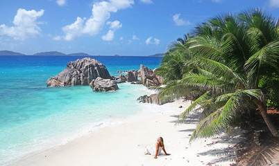 Single Blonde Sun worshiper in The Seychelles