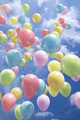 Colorful balloons flying in the air
