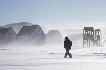 Stores à enrouleur Pôle Inuit man walking home in a winter storm, Greenland