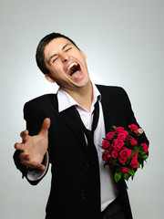 Expressions. screaming husband holding rose flower and vine bott