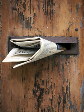 Wooden mailbox with newspaper