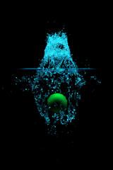 green ball drop into water highspeed