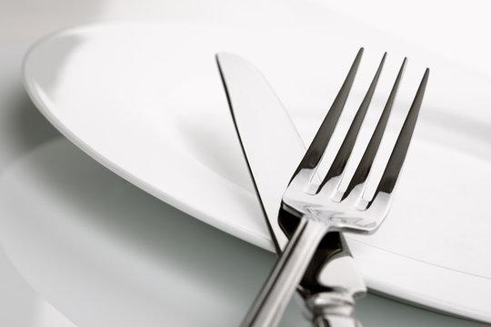 Dinner plate, knife and fork silverware