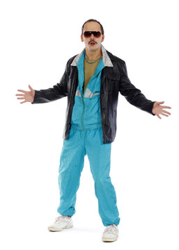 Pimp, wearing a retro tracksuit and leather