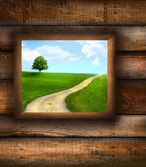 Wood picture frame on on pine wood background