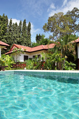 Tropical house with beautiful garden and pool