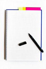 Blank notebook with a pen isolated